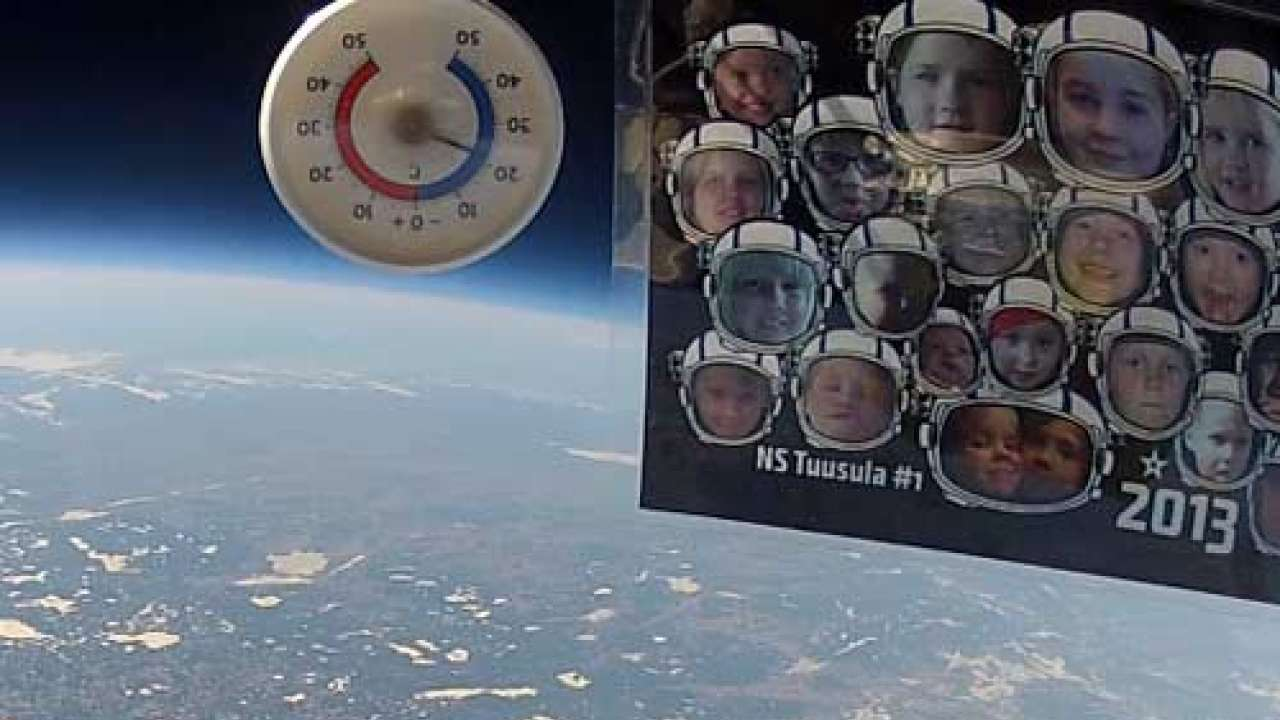 Dad sends kids' photos into space with camera attached; creates mindblowing Christmas video