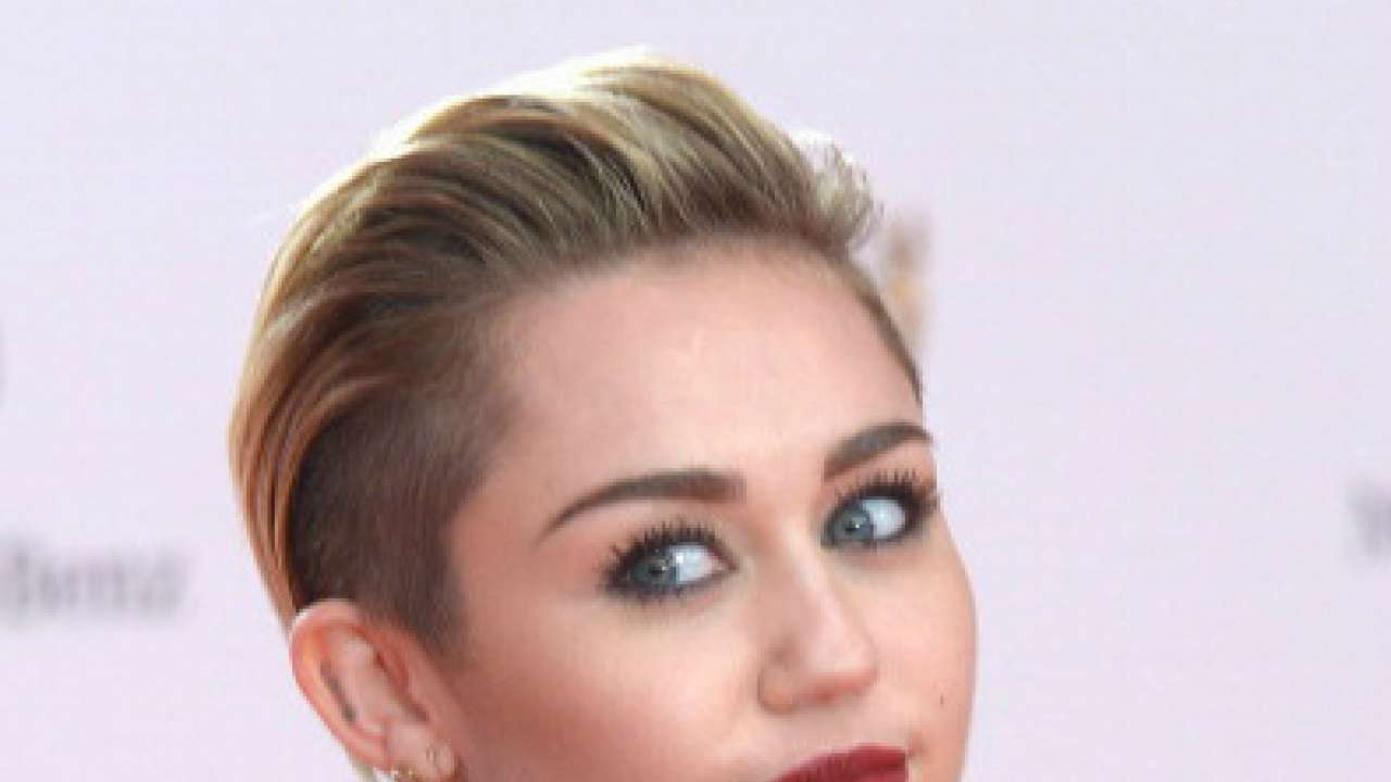 Miley Cyrus poses naked with bunch of stuffed animals