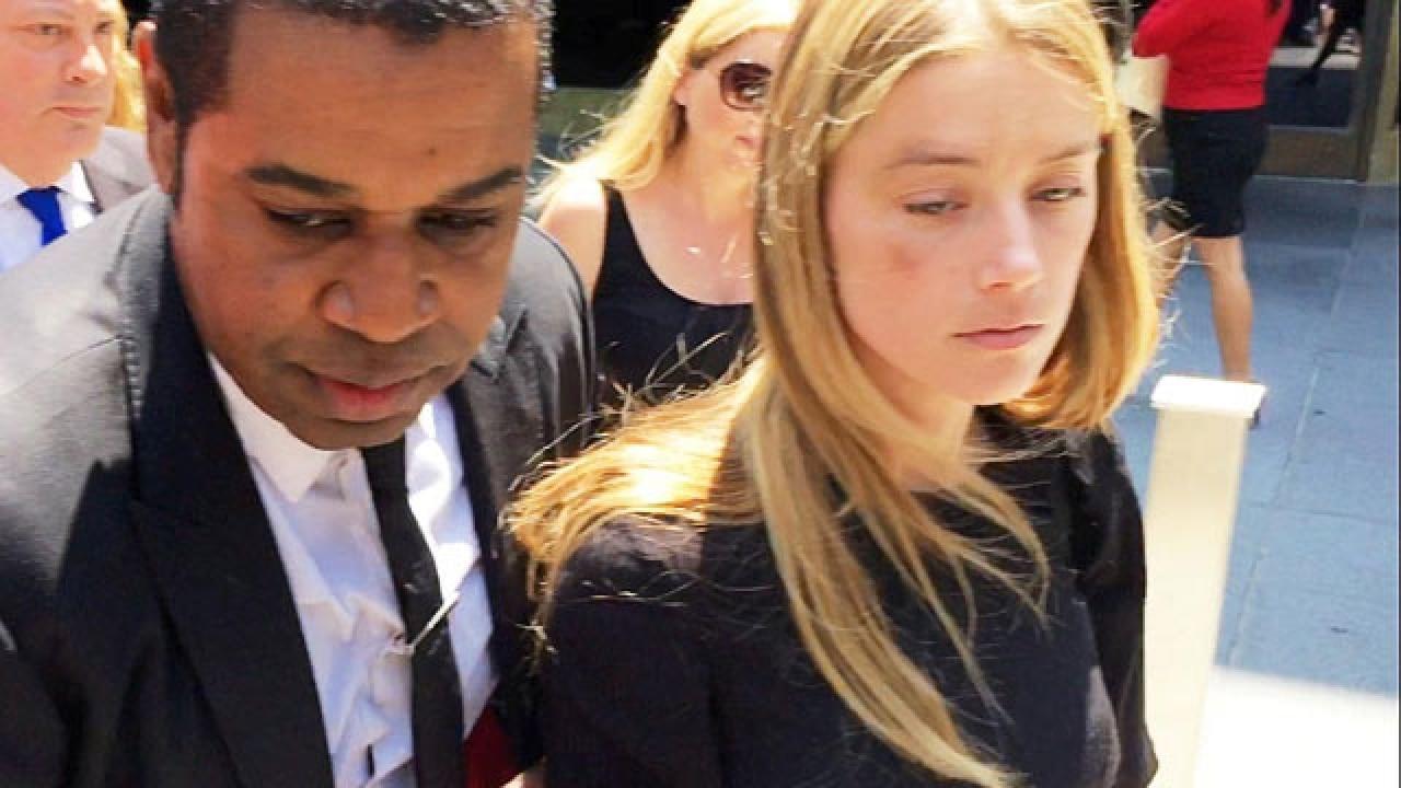 Amber Heard gets restraining order against Johnny Depp over domestic violence