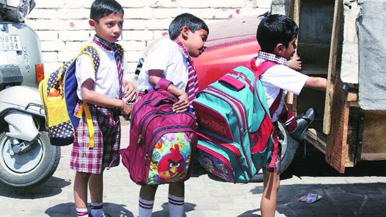 Image result for kids carrying school bags