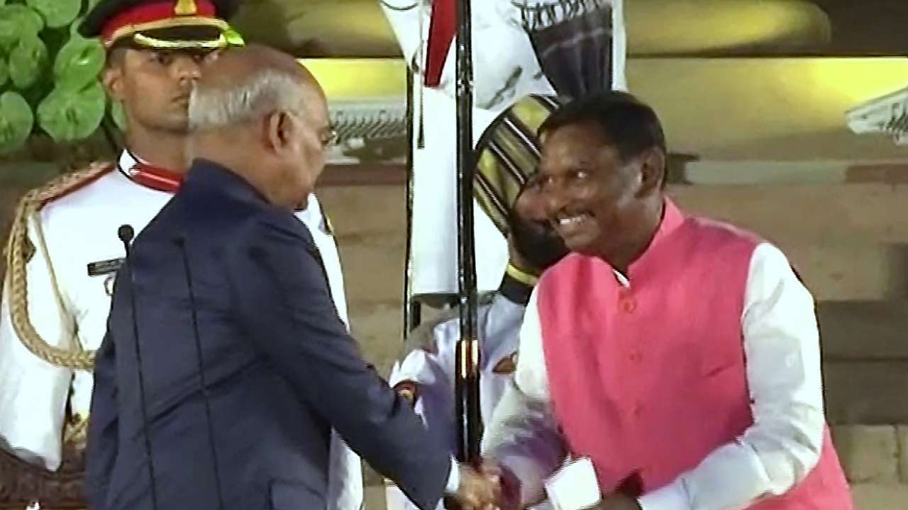 President Ram Nath Kovind greets Arjun Munda after taking the oath of office and secrecy as Cabinet Minister