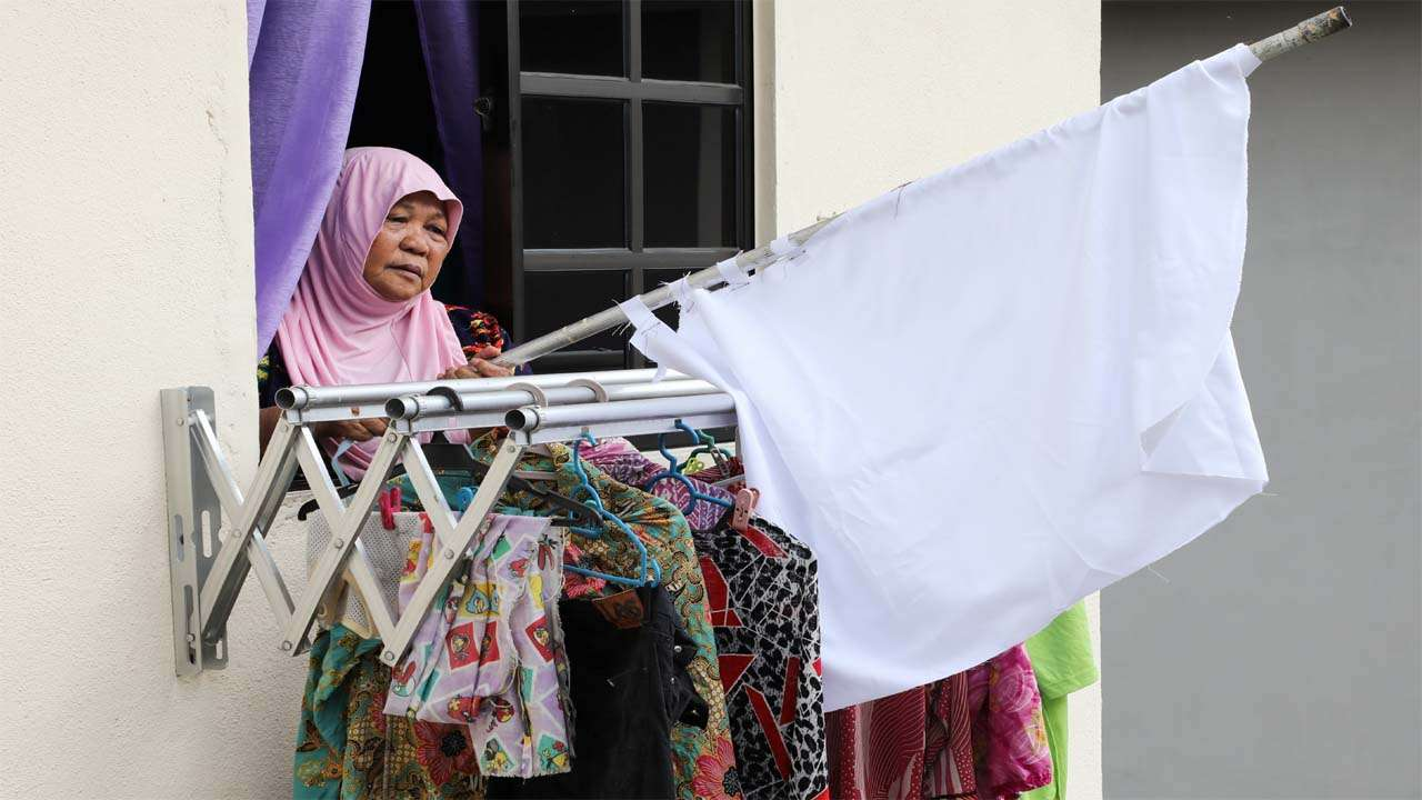 Malaysians use 'White Flag Campaign' to convey distress during COVID-19  lockdown