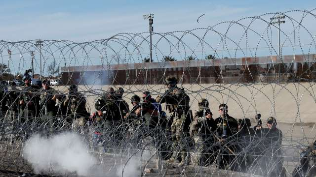US soldiers fire tear gas