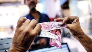 Rupee pares gains, settles 36 paise down at 70.02 vs USD