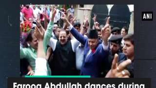 Farooq Abdullah dances during celebrations at party office in Jammu