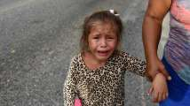 A Honduran migrant girl cries while on her way to the United States, in Rio Hondo, Zacapa, Guatemala