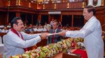 Blow to Sirisena: Sri Lankan Parliament votes against PM Rajapakse