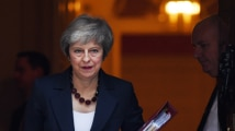 Britain's PM Theresa May faces no confidence threat, Brexit secretary...