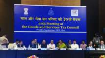 After govt's corporate tax cut, GST on hotel rooms slashed to boo...