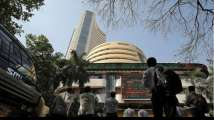 Nifty, Sensex end higher as banks surge on government support hopes