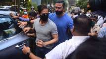 In Pics: Shah Rukh Khan mobbed by paparazzi as he visits son Aryan Khan at...